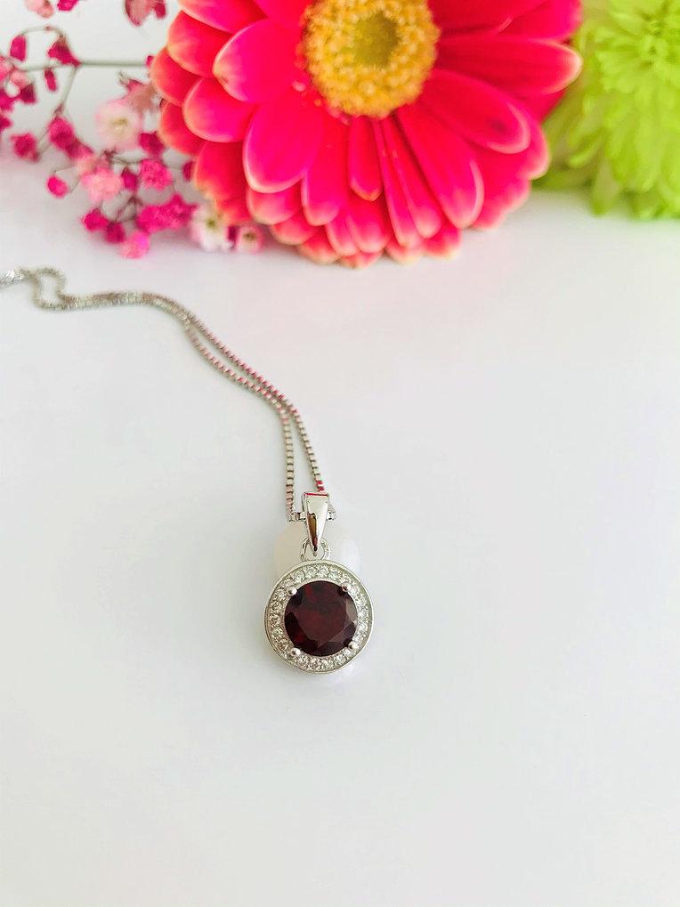 Claw-Set Round Garnet Pendant with Diamond Halo Necklace Image