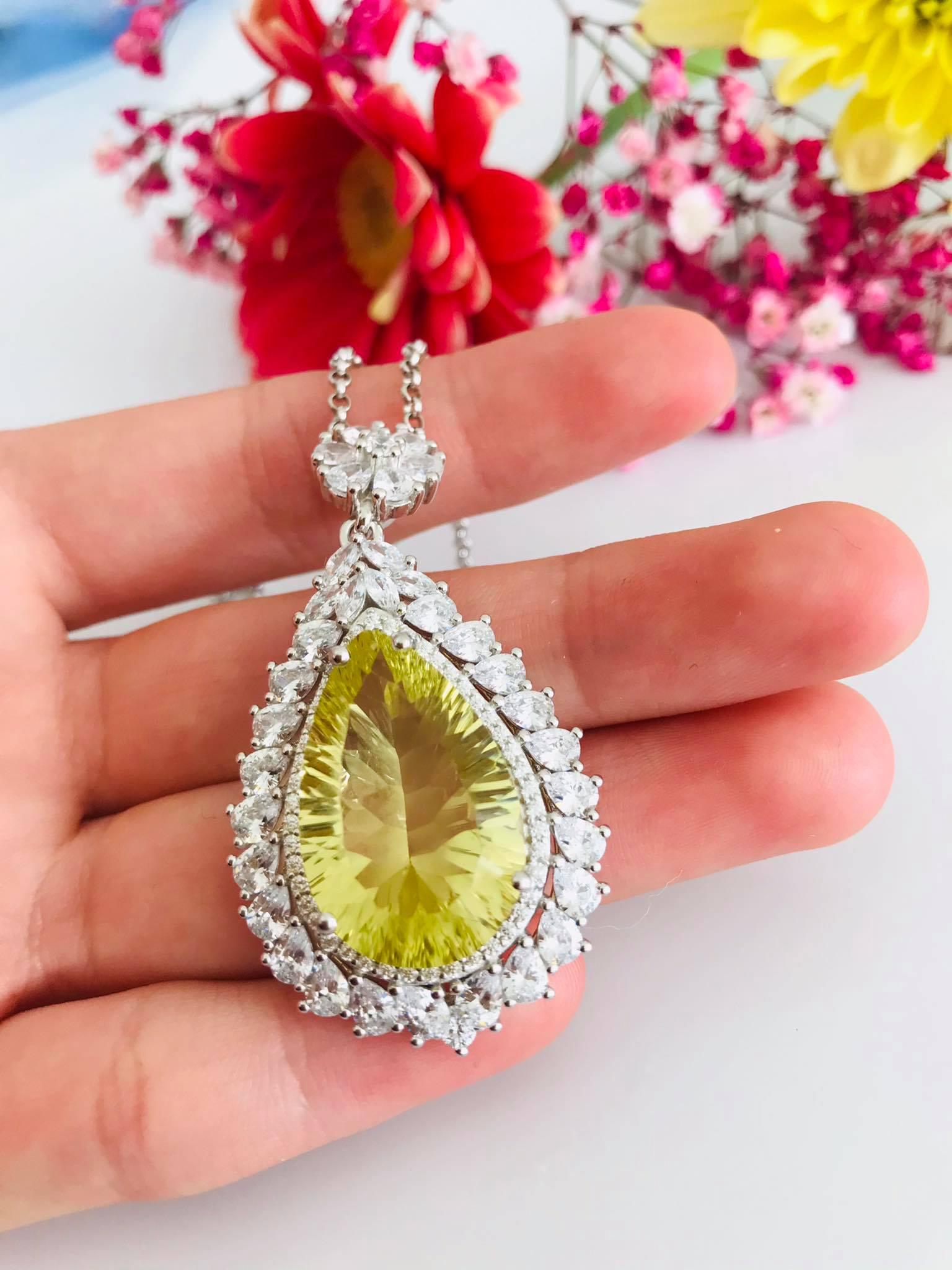 Large Brilliant Pear Shape Diamond cut Lemon Topaz Surrounded by Simulated Diamonds Necklace Image