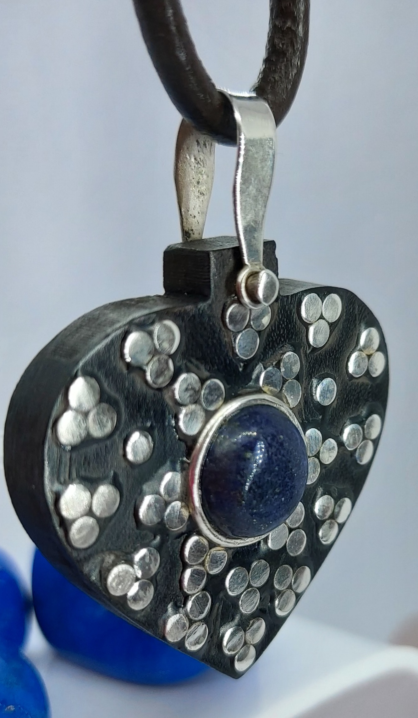 Heart Shaped Ebony, Sterling Silver Lapis pendant On a leather necklace  Image
