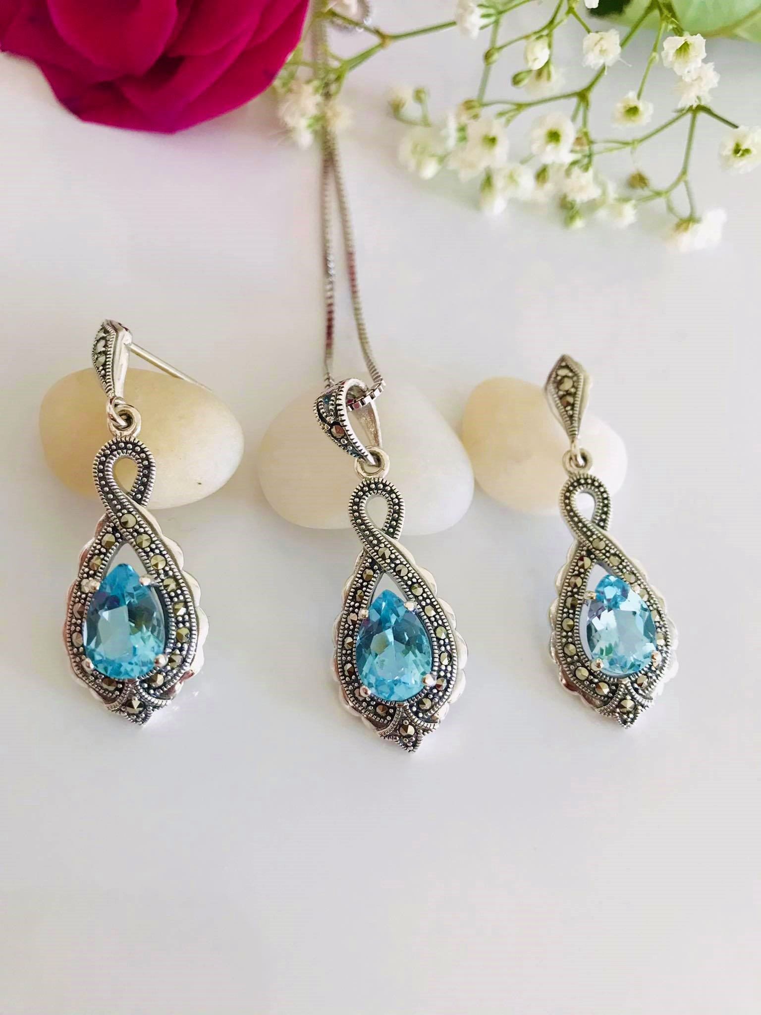 Timeless Infinity Sky Blue Topaz and Sparkling Marcasite Sterling Silver Earrings and Necklace Set  Image