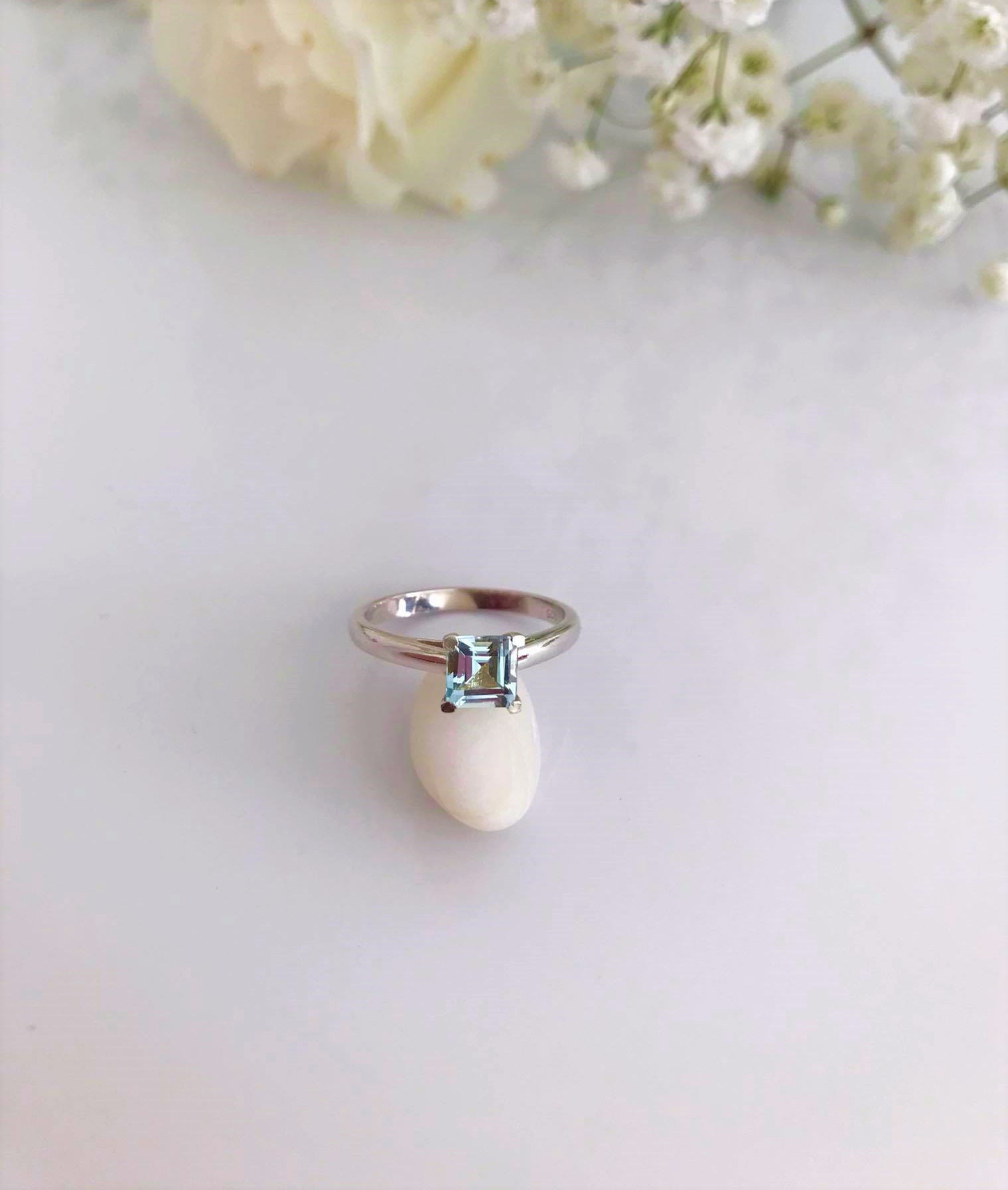 Faceted Blue Topaz set in Silver Ring Image