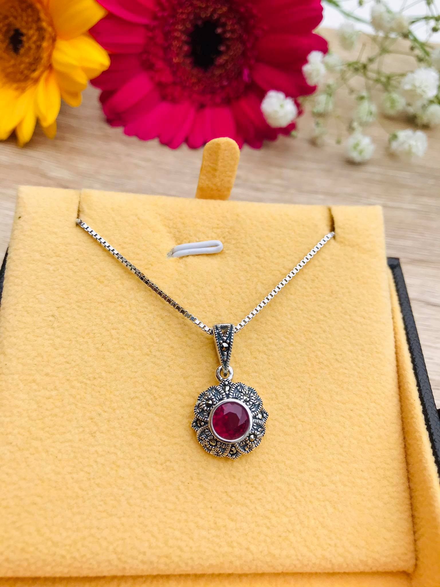 Brilliant roundcut Burmese Ruby with Sparkling Marcasite SilverNecklace Image
